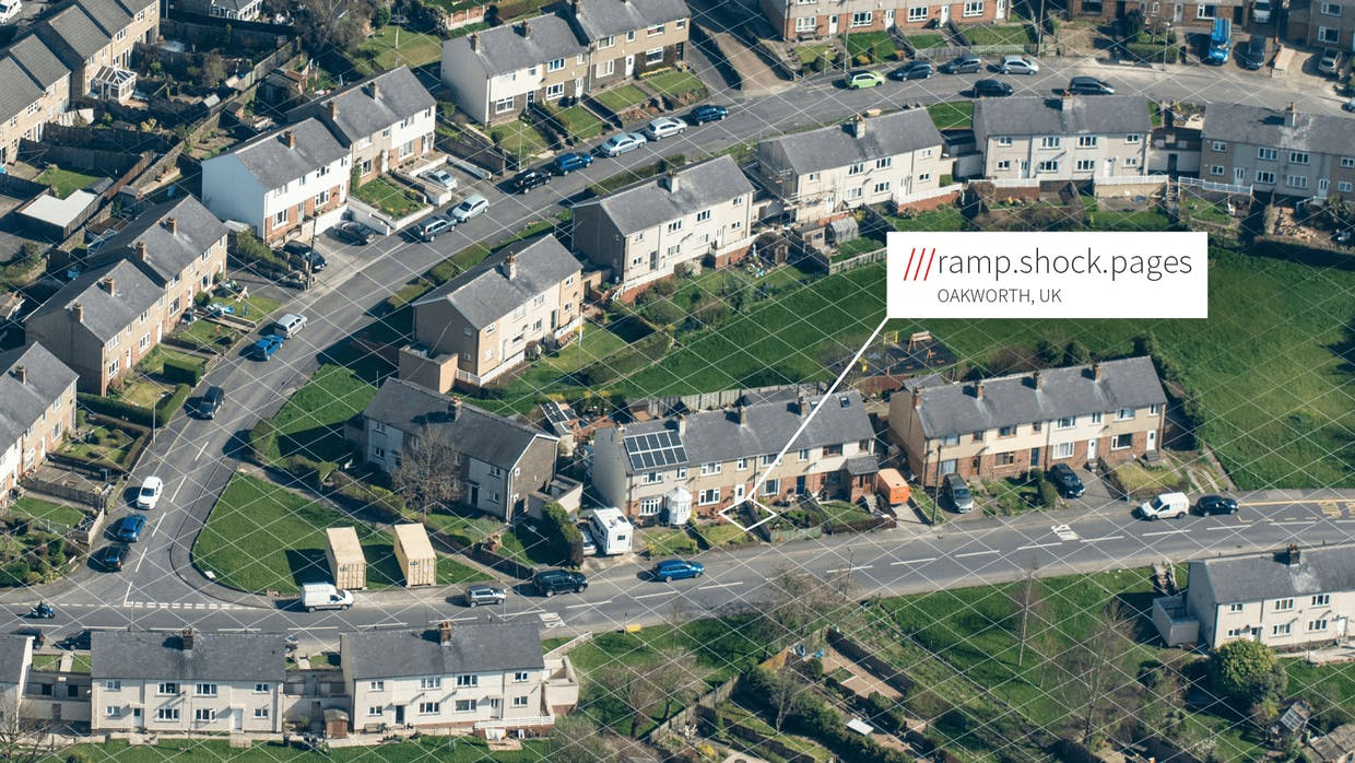 Aerial view of residential estate, one house addressed ///ramp.shock.pages