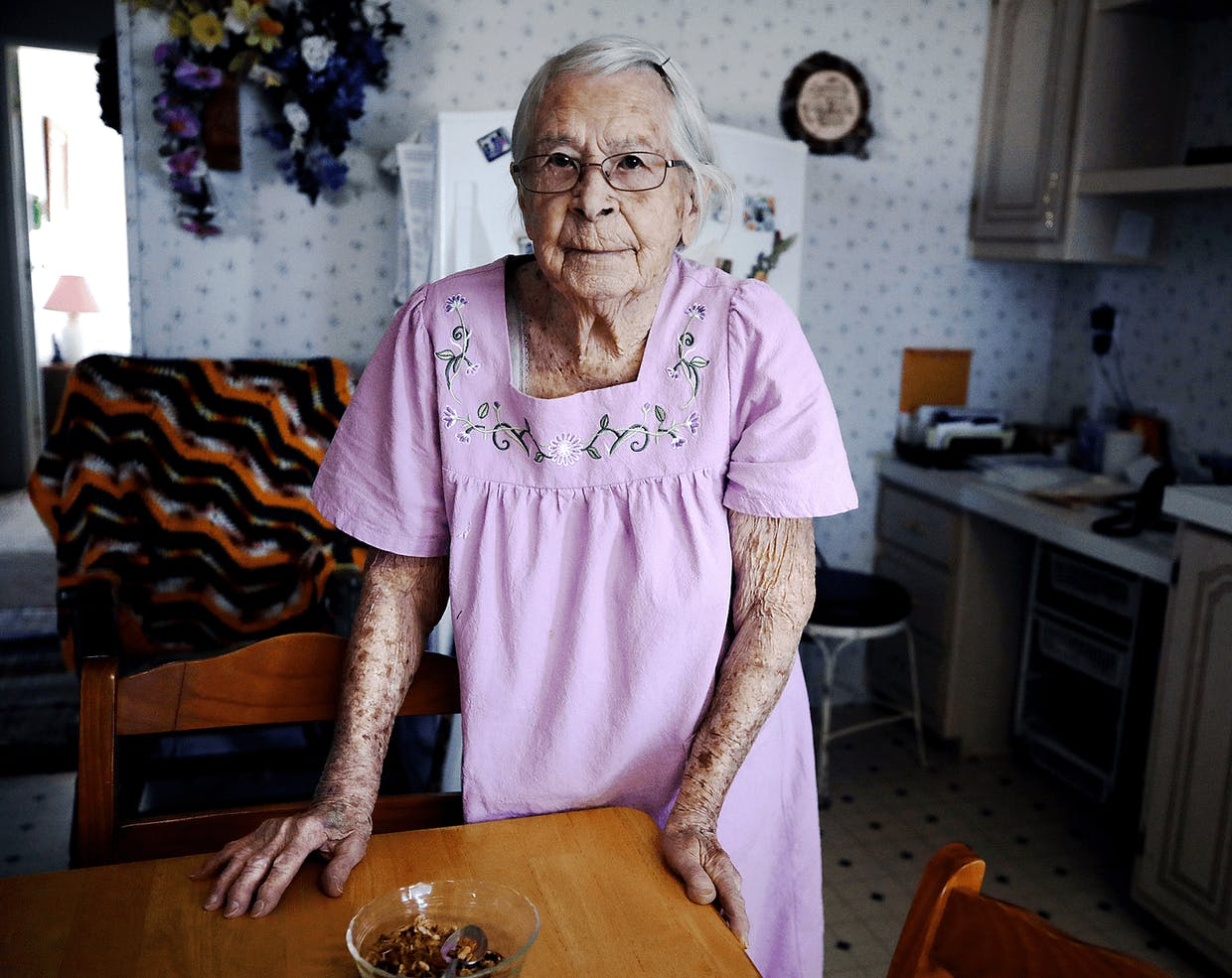 Local gardening legend Pearl O'Neill stands in her kitchen Thursday. O'Neill celebrated her 105th birthday in February.