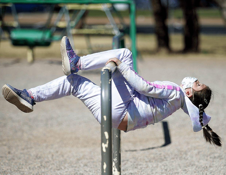 Bella Vista Elementary School 2nd grade student Faith Coffey spends part of her Tuesday on the school playground in Sierra Vista.