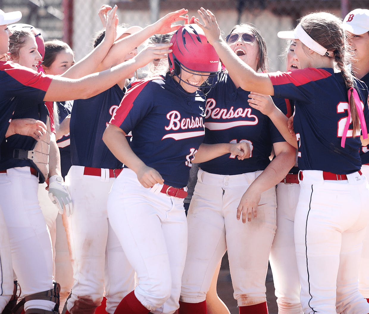 Teresa Garza, senior, is mobbed after clouting a solo shot in Saturday's game in Benson against Payson.