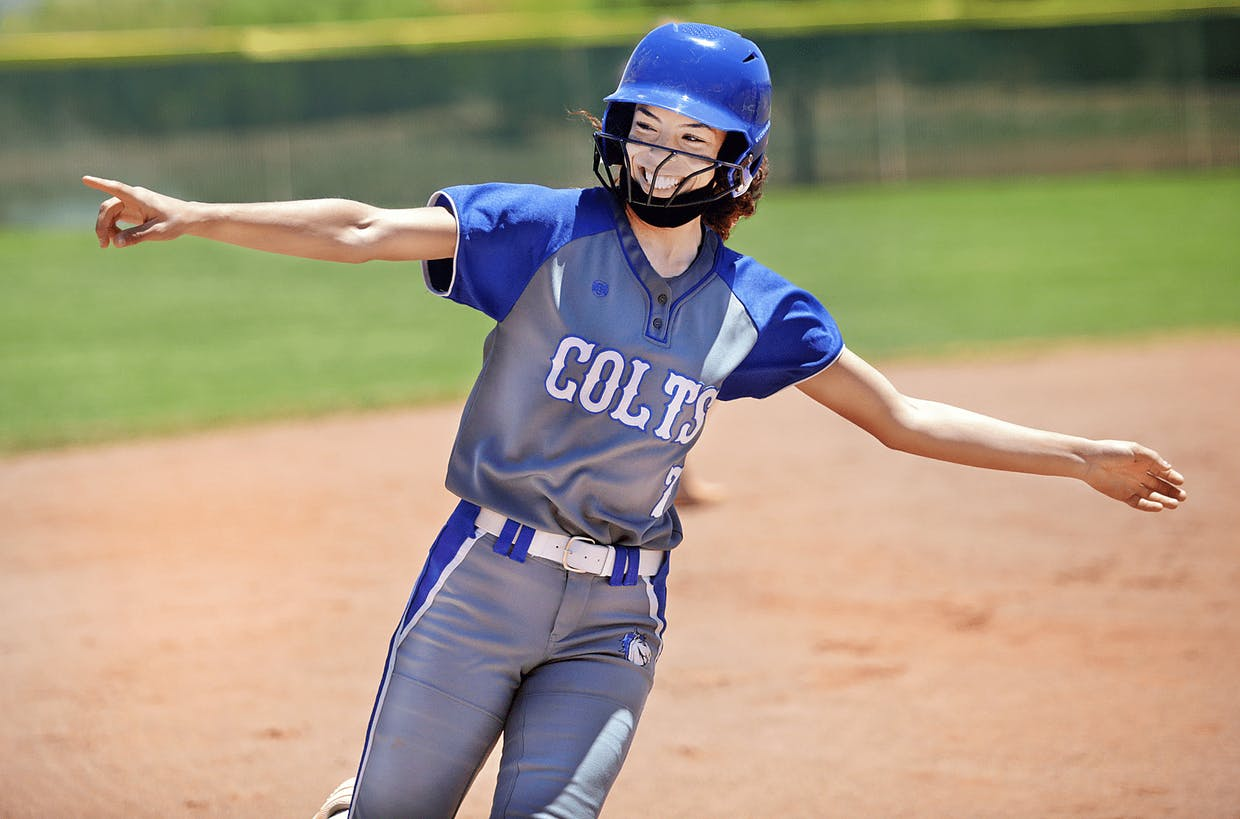 Buena senior Jazmyn Gilliam acknowledges her teammates while rounding the bases after hitting a solo home run in the fourth inning. The homer was the first run of Saturday's first-round Class 5A state tournament game against Peoria Centennial in Sierra Vista. The Colts won 3-1.