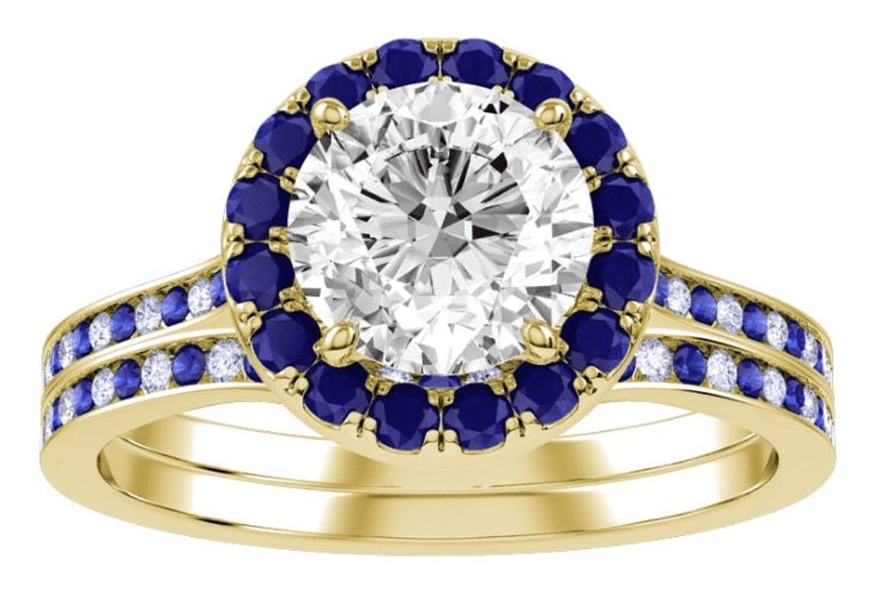 My creation features 10k yellow gold, a colorless center diamond and sapphire halo with alternating diamonds and sapphires along the band of the ring and wedding band.