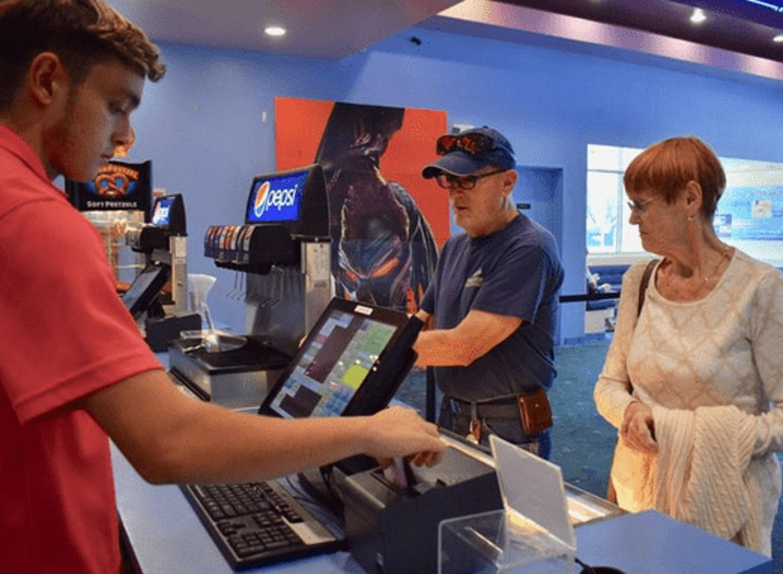 Patrons pay for tickets in 2019 at High Sierra Desert Sky Cinema in Sahuarita.