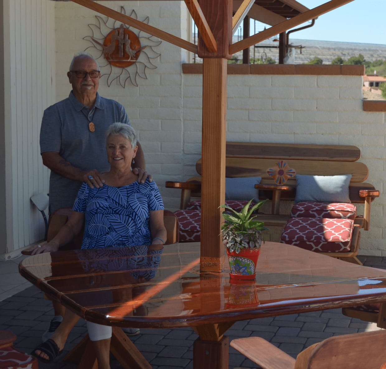 Wayne and Gayle St. Amour enjoy the shade and comfort of their covered redwood patio table with matching chairs that Wayne built.Karen Walenga | Green Valley News