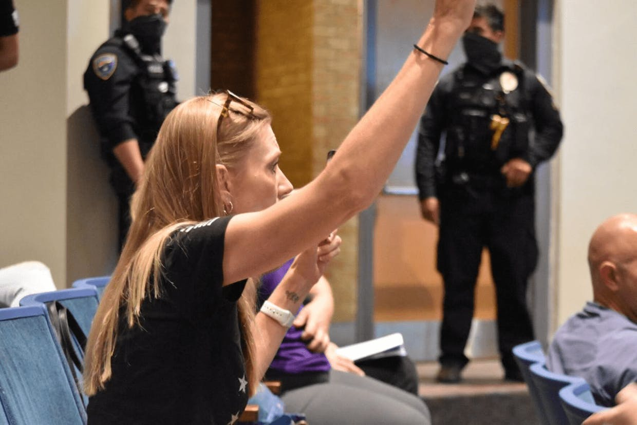 SUSD parent Cory Stephens demands a chance to speak after the call to the public was going to be ended. Photo by Jamie Verwys