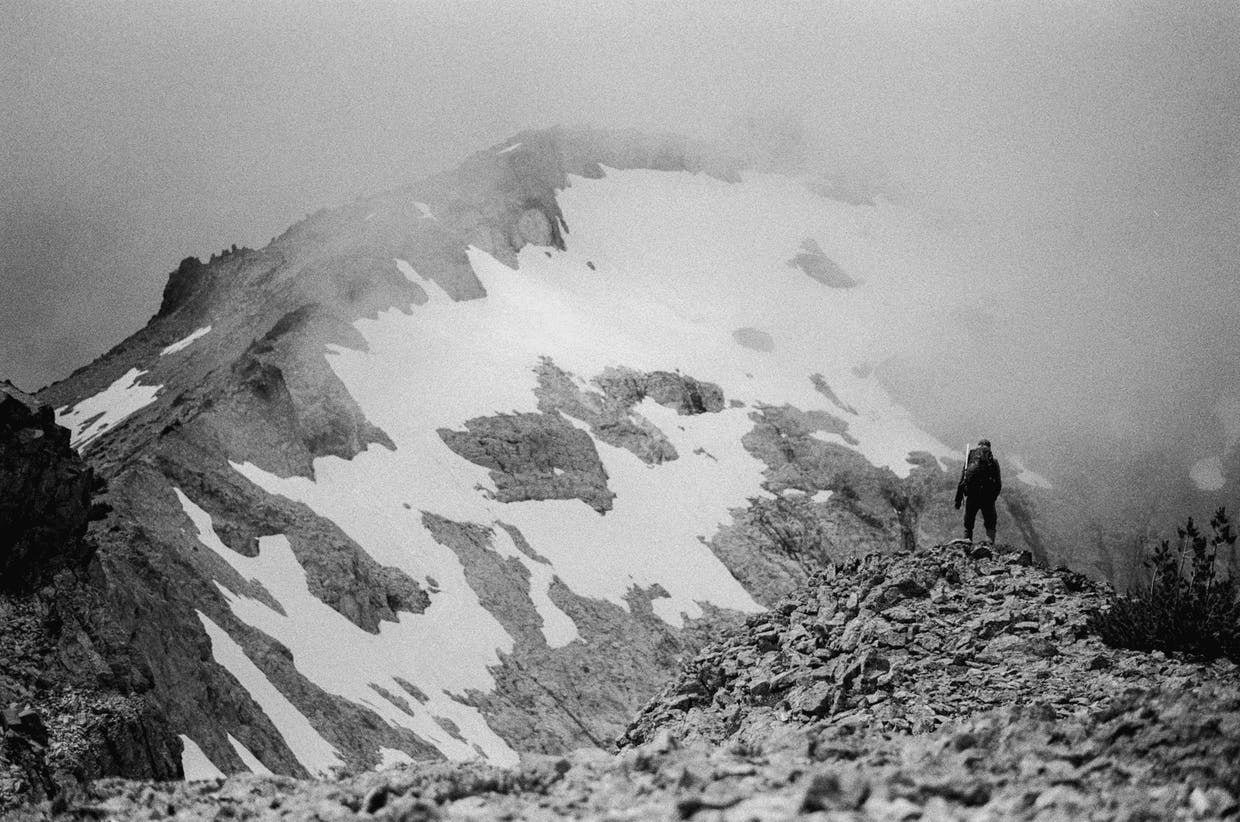 Cody Cottier peers off at Mt. Daniel during a scramble up the left ridge of the mountain, July 21.
