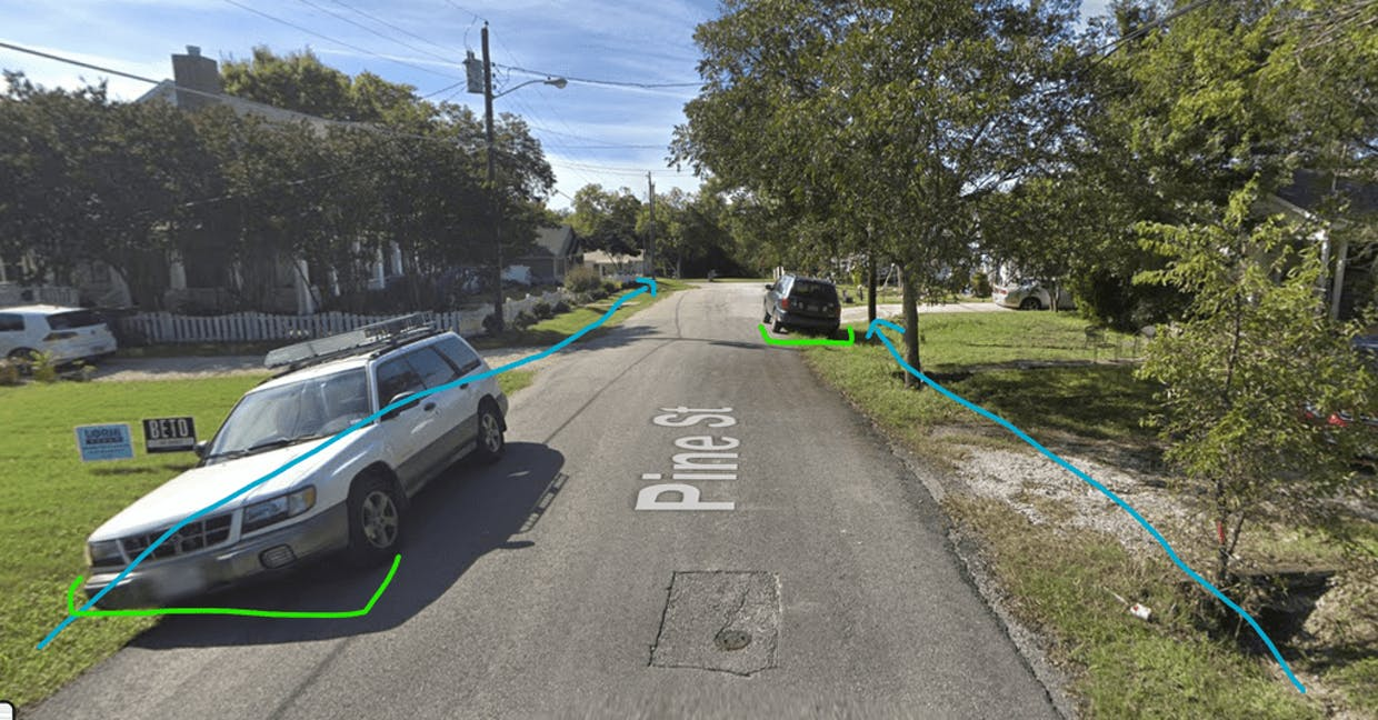 Pine Street: Ditches in blue, vehicles parked partially on the road highlighted in green.