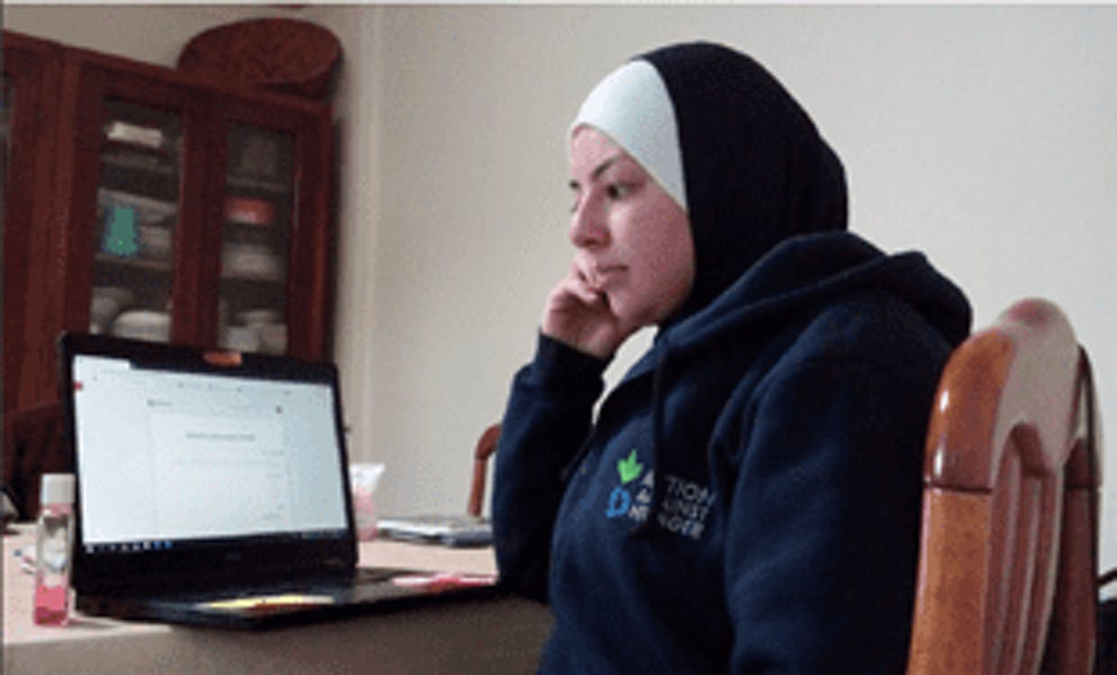 Zeina Algharaibeh, a WASH supervisor with ACF Jordan, listens to the opinions of populations about COVID-19 via their phone service.